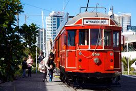 Mother helping child into Auckland Tram
