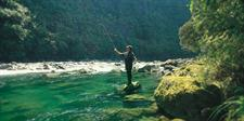 Fly fishing in the river at Treetops Lodge, Rotorua