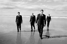 Groomsmen enjoying the sand between their toes
