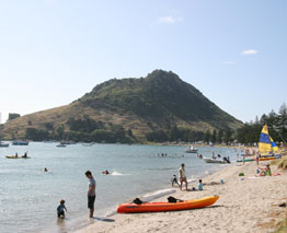 Mount Maunganui, (Mauao) is a dormant volcanic cone resting at the end of the town's peninsula bearing its name