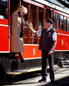 Tram staff helping passenger