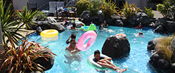 Relax and unwind in our outdoor heated pool at Baycrest Lodge in Taupo