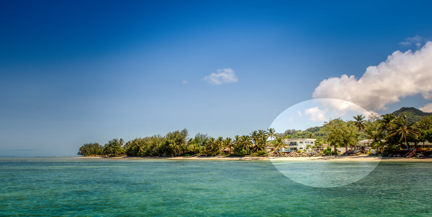 Luxurious living spaces open right onto the white sands of Rarotonga's Muri Beach and Lagoon