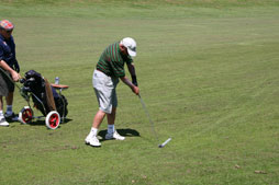No player should talk, stand close to or directly in the line with the hole, or make any movement that may distract a fellow competitor while making a stroke