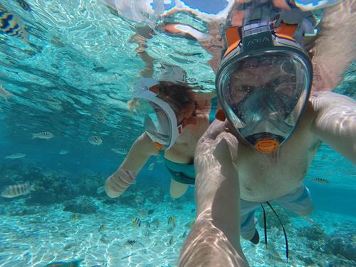 Ali Adam and Hubby, Jeff Adam, snorkeling off Le Taha's Island Resort on their Tahiti Trip