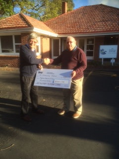 Nicholas Wynne, Lions of Bethlehem Te Puna (right), presents Barry Davies, Te Whanau Kotahi with the cheque