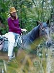 Horseback riding through the bush