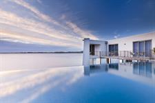 Hotel infinity edge pool blends with sea and sky