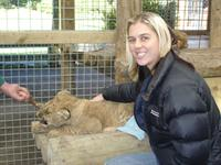Kelly and lion cub at Paradise Valley