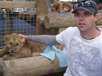 Mark and lion cub at Paradise Valley