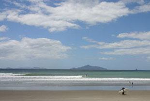 Surfing at Waipu Cove